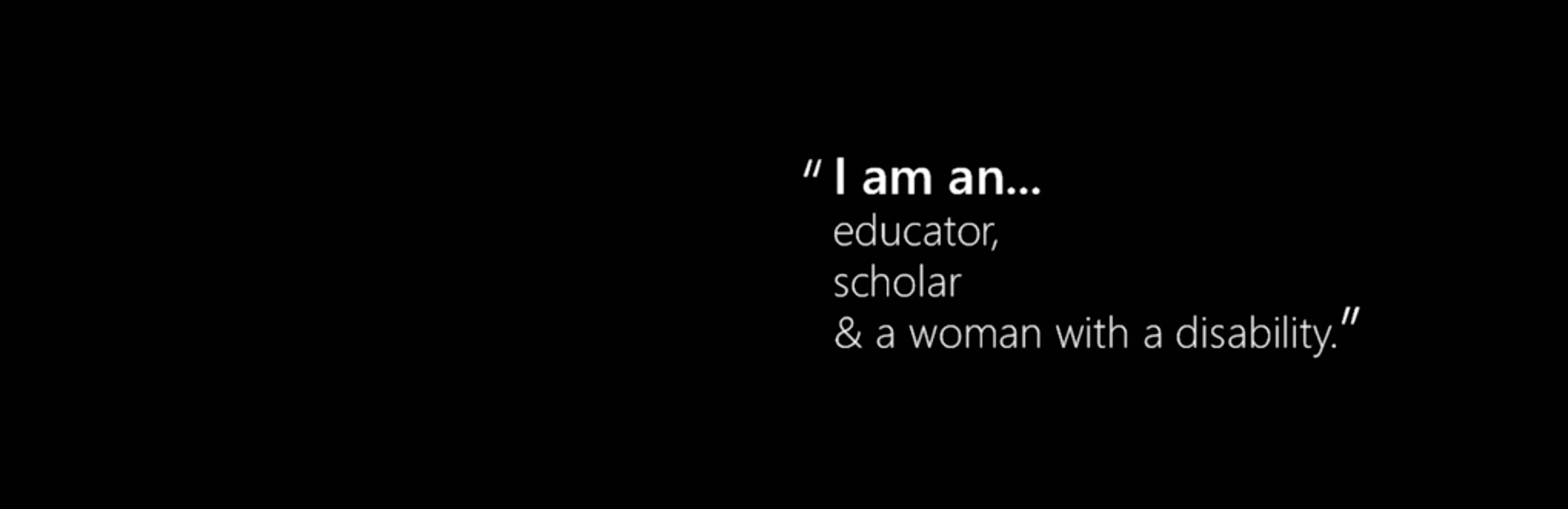 "Still from video of RGT with text that reads ""I am an educator, scholar, and a woman with a disability."""