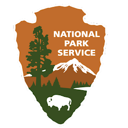 Logo of the National Park Service, featuring a tree and a buffalo